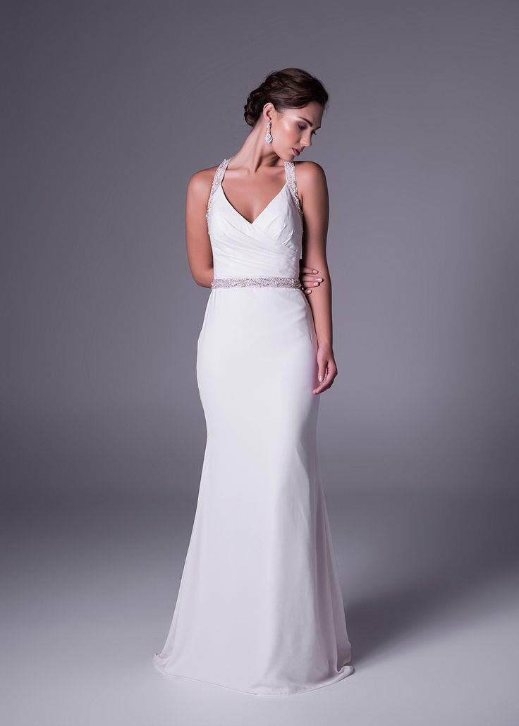 Simple but oh-so sexy. Glam details in in this #wedding #dress straps and waist make it the ultimate look for a #classy halter neck and #chiffon #weddingdress. #OlegCassini gown available in #SouthAfrica exclusively from @brideandcosa Style: SWG645 #brideandco #brideandcosa