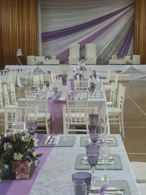 Stage draping old community hall, shades of purple, silver and white