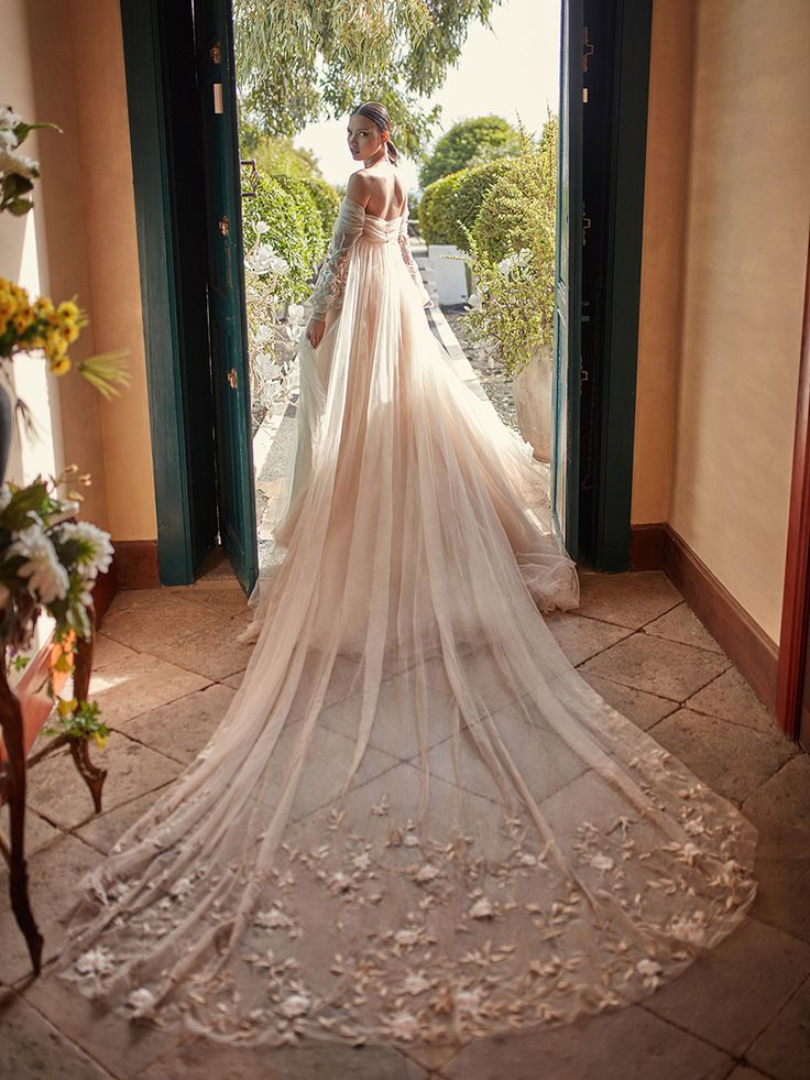 """""""Magnolia"""", a corseted ballerina ballgown made of soft silk tulle, a draped corset and a sheer voluminous skirt // Inspired by a bride's desire to express her individuality through a signature scent and wedding day style, Galia Lahav's Fall 2018 Florence by Night Couture Bridal Collection saw new approaches to gossamer tulle, fine lace and intricate embroidery."""