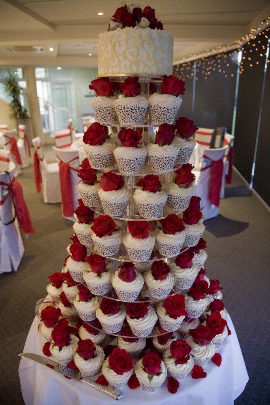 Tower of cupcakes with red-rose- Don't forget red personalized napkins to match your theme!!! #itsallinthedetails #redwedding www.napkinspersonalized.com