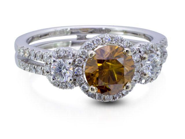 Orange Diamond Ring - Natural fancy brownish orange Seng Firey Diamond™ that weighs .95 ct. set in 18K white gold ring.