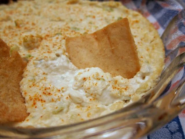 2 pkg or 2 cans crabmeat  1 lb cream cheese, softened  1/2 cup mayonnaise  1 bunch green onions, chopped  2 dashes red hot sauce  2 tsp worcestershire sauce    Preheat oven to 350.  Mix all ingredients together and pour into baking dish.  Bake at 350 for 20 minutes.  Serve with rye bread, pita chips, crackers and/or vegetables.