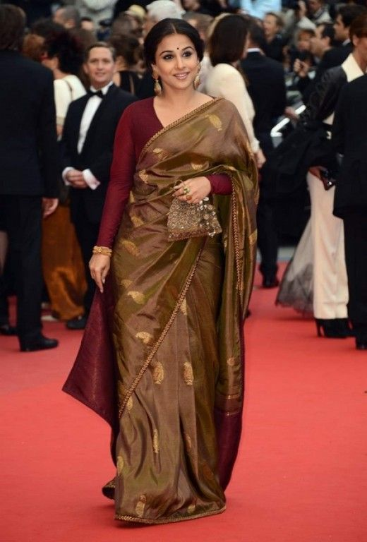 Vidya Balan wearing a sober Sabyasachi saree with maroon full sleeve blouse.