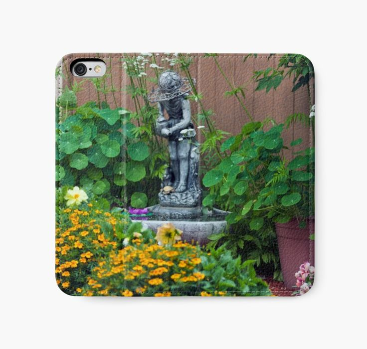 iPhone Wallet. https://www.redbubble.com/people/sandrafoster/works/9192660-backyard-garden-summer-scene?p=iphone-wallet