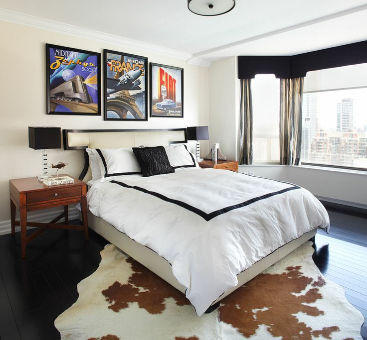bright posters add color to a chic bedroom in black and white poster power add a touch of vintage vibe and showmanship to modern interiors