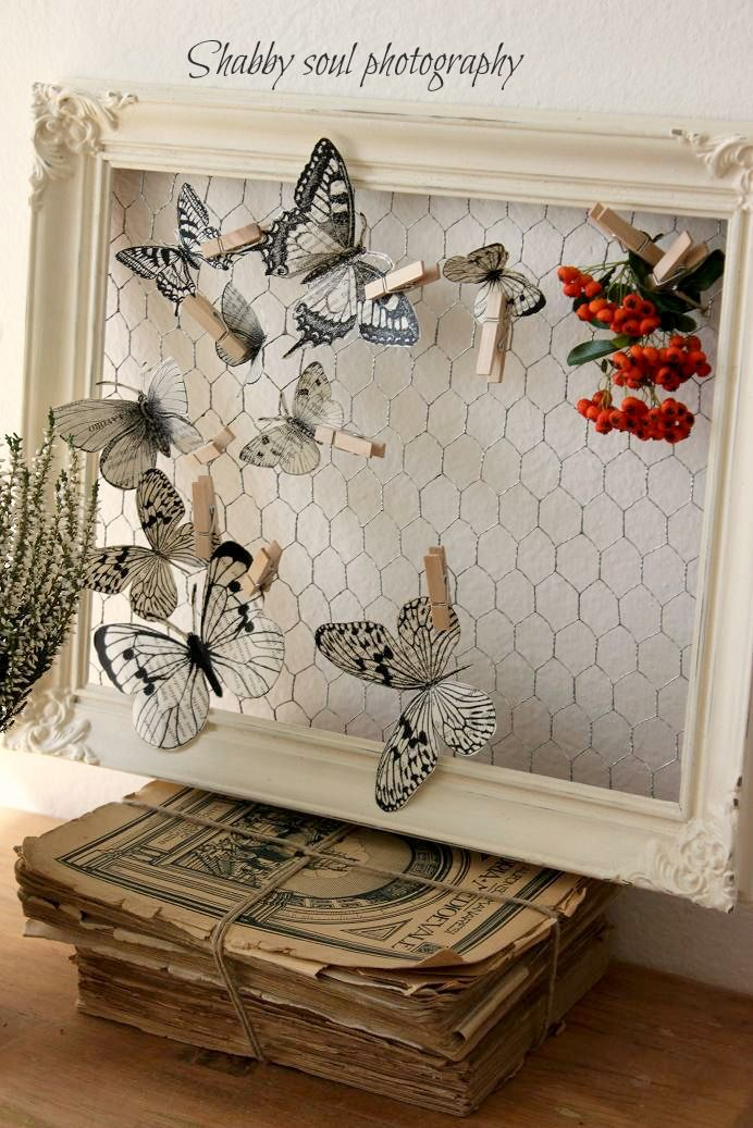 #butterflies printed on book pages - chicken wire backing for frame, attached with wooden clothespins bookpages chickenwire