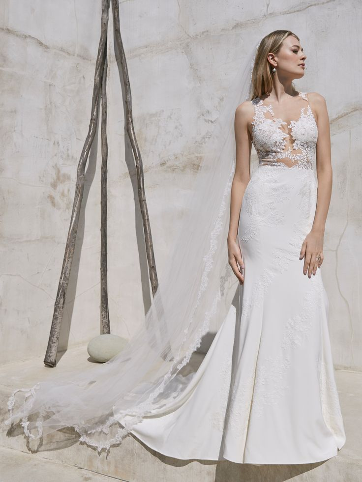 An alluring mix of lace and stretch silk crepe our