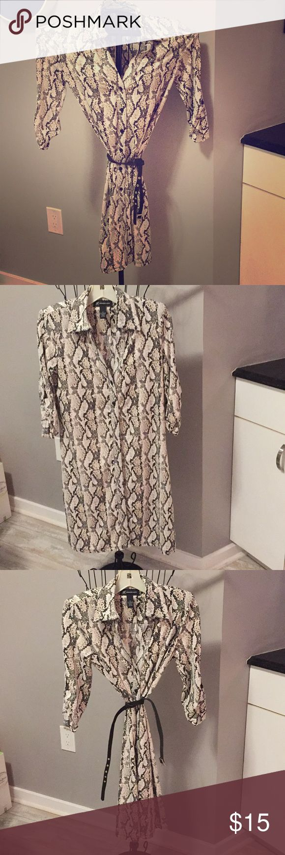 INC dress INC dress . Button down shirt style . Python print . Did not come with belt but I wire the one shown in pic , will include . Black, cream .  Great work dress . Great condition ! INC Dresses