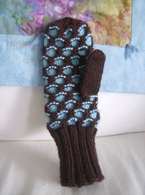 Newfie Mittens.  There is also a hat pattern hidden in the comments.