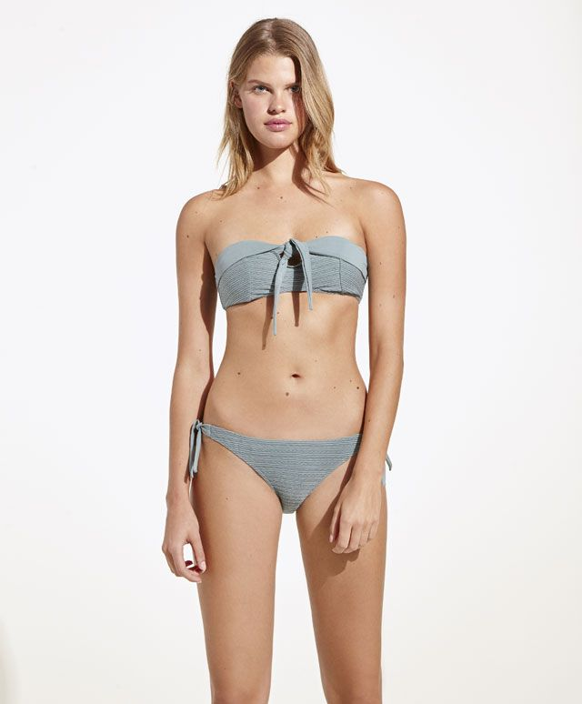 Dyed green bandeau bikini top, 19.99£ - Garment dyed, bandeau bikini top without padding or underwire. - Find more Spring Summer 2017 trends in women fashion at Oysho.