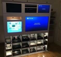 Awesome custom video game shelves via Racketboy user wheeezy. Gaming unit with consoles, HDTV and CRT TV for retro games. Stylish game room.