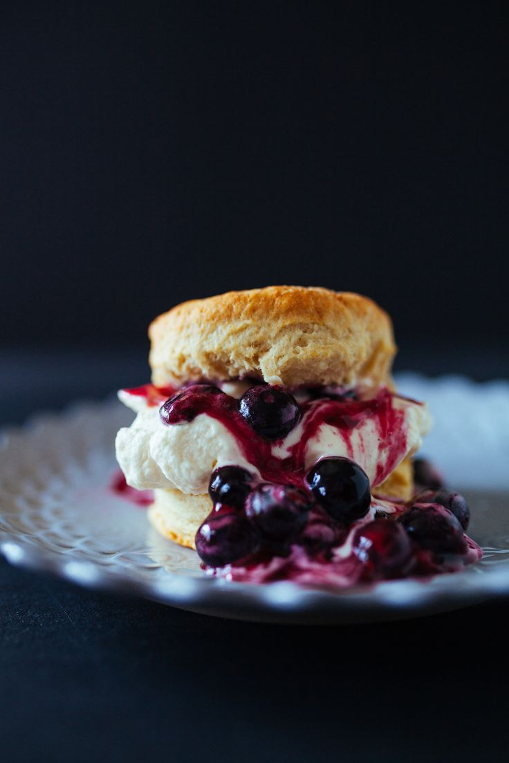 Flaky homemade biscuits stuffed with summery blueberry compote and fresh vanilla whipped cream.