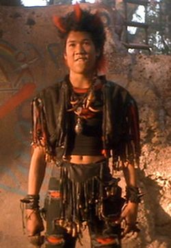 "Personally I find the ""Rufio"" look to be the best outfit when traveling internationally.  It screams ""worldly sophistication"" and ""cultural sensitivity,"" you'll make friends w/the locals."