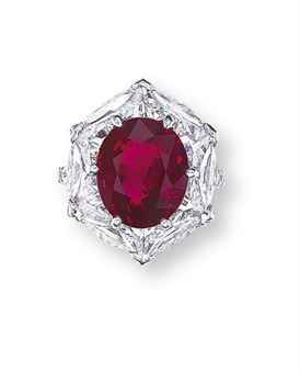 A RARE RUBY AND DIAMOND RING, BY ETCETERA   Set with an oval-shaped ruby weighing 6.16 carats, within a surround assembled by shield and triangular-shaped diamonds, to the pavé-set brilliant-cut diamond gallery and hoop, mounted in 18k white gold