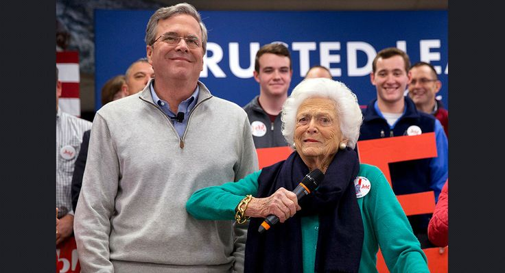Barbara Bush, right, jokes with her son, former Florida Gov. Jeb Bush, while introducing him at a town hall meeting at West Running Brook Middle School in Derry, N.H., on Feb. 4. (AP)