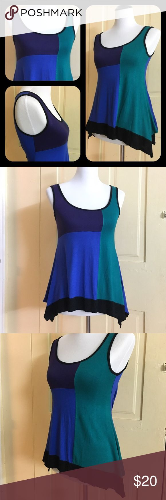 Dress Barn Sleeveless Flowy Top (petite small) This adorable flowy top from Dress Barn will hug your curves in all the right spots!😉 Colors: green, blue, and purple with black trim.  Women's size petite small (but the sizes run a bit large... plus the fabric is stretchy).  95% rayon, 5% spandex.  Made in the USA. Dress Barn Tops Blouses