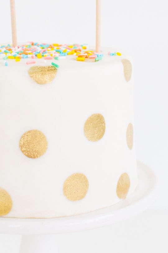 Mix edible gold dust with almond extract for polka dot cake