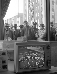 Chicago, November 1963. Passersby watching JFK's funeral on TV in store window, unknown source.