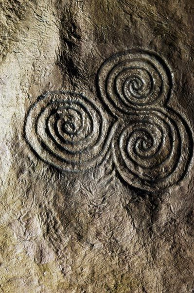 Celtic Triskele (Triple Spiral) Stone Carving, Newgrange, Ireland ~ symbolic of the three realms: Land/Sea/Sky or the Triple Goddess (phases of womanhood): Maiden/Mother/Crone