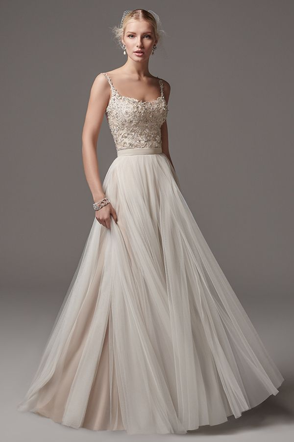Lookbook of beautiful bridal and bridesmaids gowns, exquisite details and various styles and colors. Easily navigate to the style that fits you best.