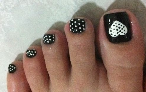 Black Toenail Polish with White Polka Dots! Make sure you go to http://www.nailmypolish.com for more amazing Nail Polish Colors & Designs!