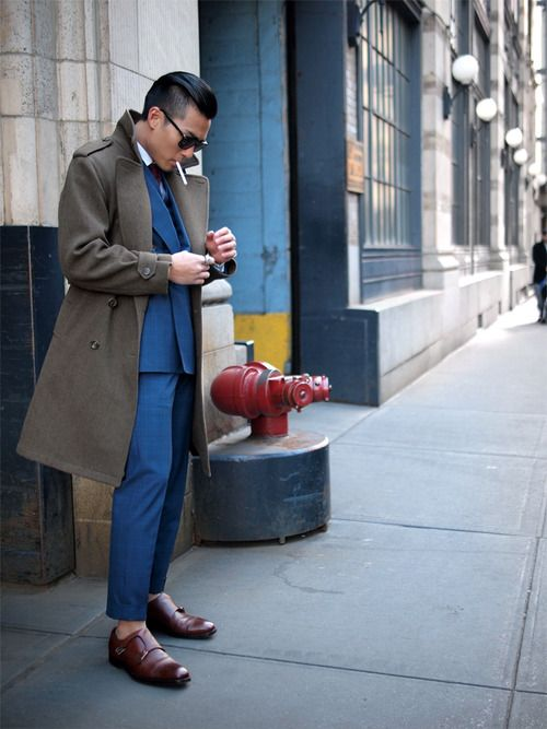 Kevin Wang in HVRMINN double-breasted suit. Overcoat by Vietto NYC. Sunglasses by Persol. Shoes by Sid Mashburn.