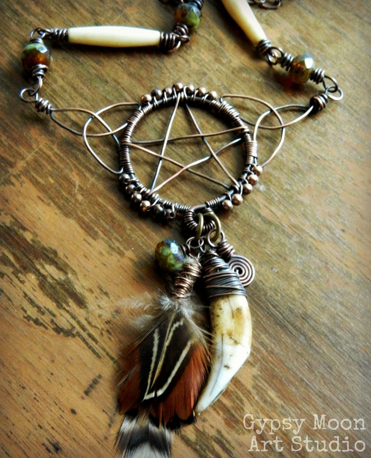 Celtic Knotwork Pentacle.  Celtic Tribal Copper Wire Wrapped Pentacle Pentagram with Tooth, Bone, and Feathers. via Etsy.
