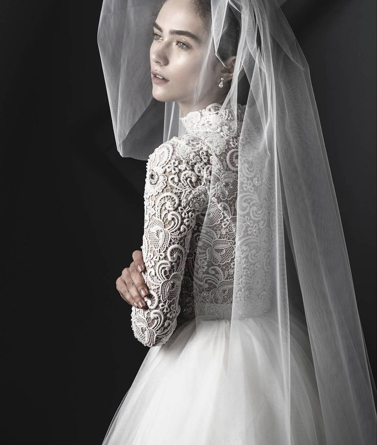 Ivory macrame lace high necklinethree quarter length sleeve ss 18 Miss Sharp wedding dress.