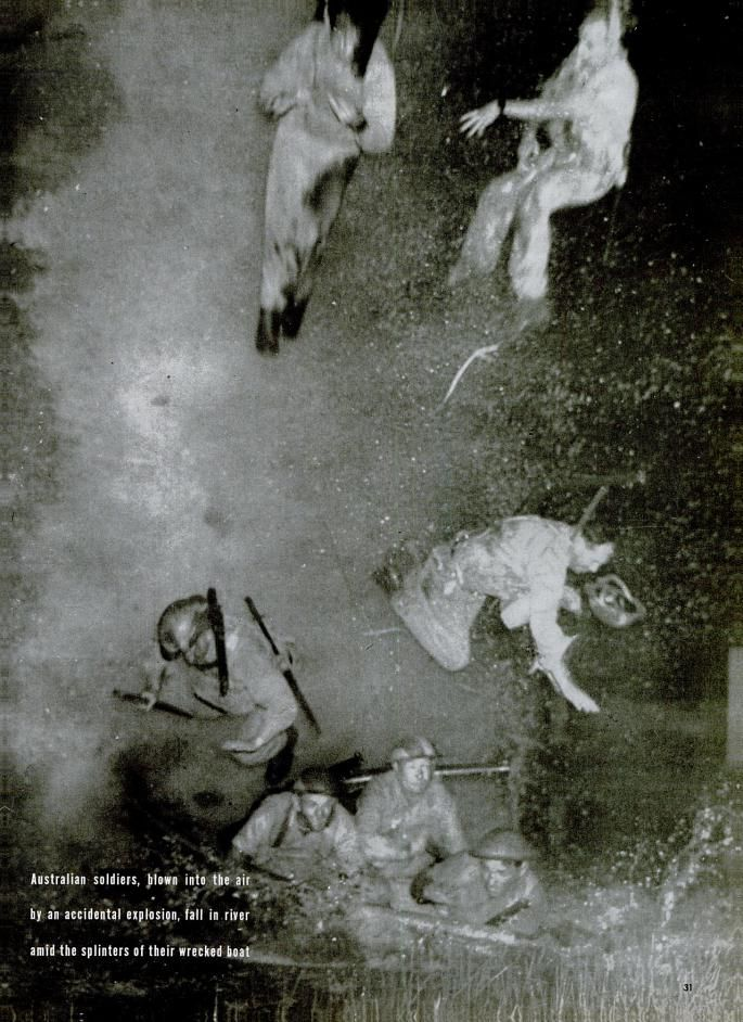 Australian officers, blown into the air by an accidental explosion, fall in the river amid the splinters of their wrecked boat. 1942.