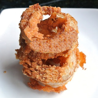 ONION RINGS GLUTEN FREE 2 cups canola oil  1 large sweet onion   1 cup gluten free all purpose flour  1 teaspoon baking powder  1 teaspoon sea salt  1 large egg, lightly beaten  1 cup milk  1/2 cup crushed tortilla chips      1/2 cup crushed potato chips