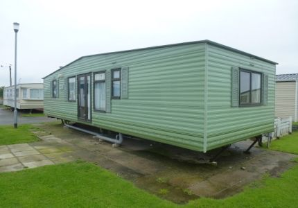 2001 Cosalt Country 36 x 12 2 Bed for sale on Golden Gate including 2014 site fees. The caravan is very unique with a center lounge and 2 large bedrooms either end of the caravan, both equipped with en-suite bathroom with toilet, sink and shower. The caravan also benefits from electric panel heating. It is in excellent condition inside and out. £11,500 including 2014 site fees!