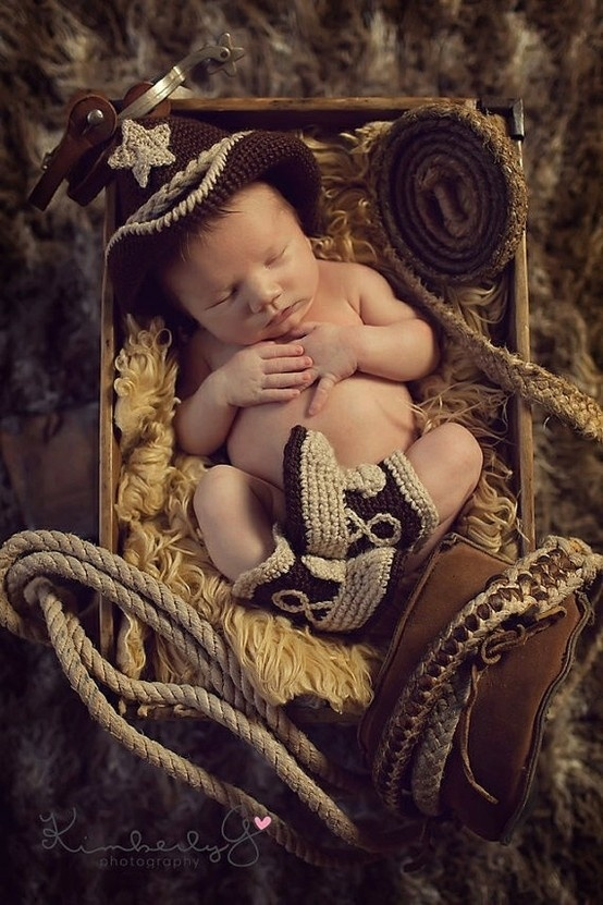 cute western baby....if we have a boy I have 2 do this just 2 make fun of joe.....
