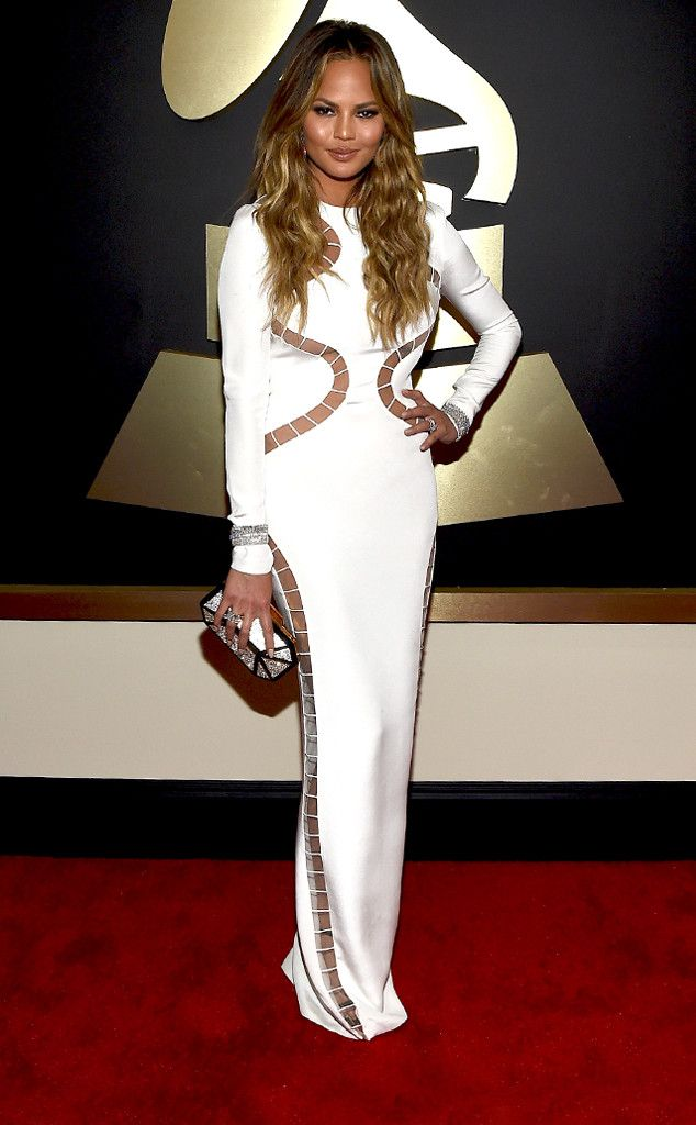 Chrissy Teigen from Best Dressed at 2015 Grammys | E! Online,,,I originally stated that the dress reminded me of the ladders board game, but after seeing again, I do like it and Chrissy pulls it off. She looks sexy and elegant at the same time.