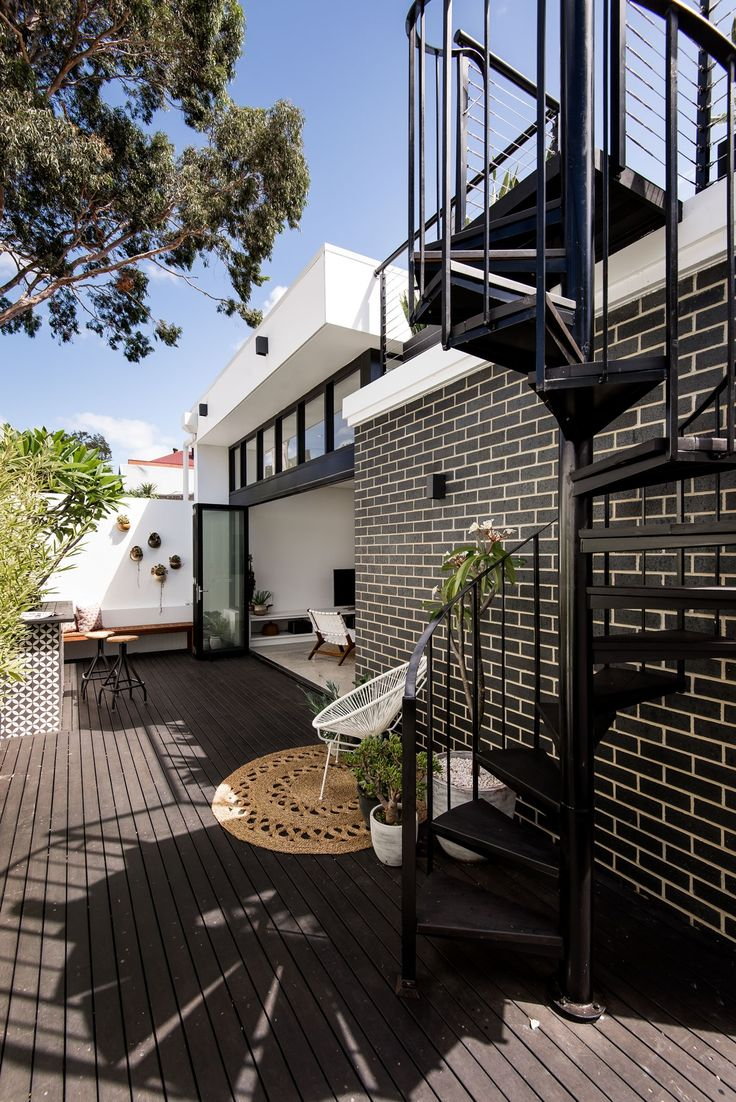 West Leederville Renovation by Studio Atelier - Rear courtyard with spiral stair to roof deck garden