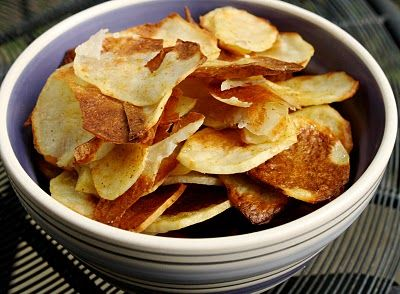 Baked Potato Chips -- NO OIL!  Four stars on this one!  Easy to make, inexpensive, NO FAT & Tasty!  These really do come out crunchy.  You can use whatever seasonings you like but I opted for a basic salt seasoning.  VERY GOOD!!  You will want to use a mandolin cutter or a cheese slicer because you want thin potatoes but that is the only challenge I could forsee.  TRY THESE!