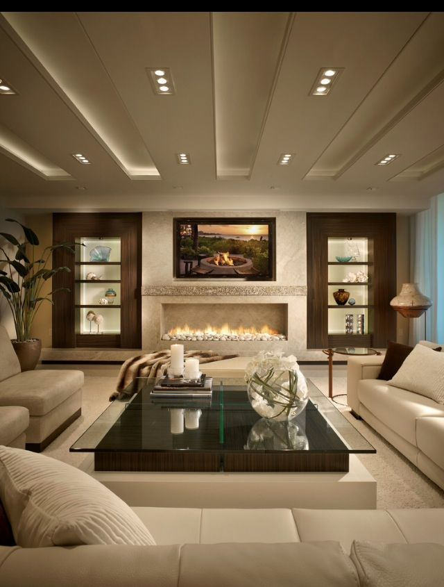 Idea to use ~ Built in lighted shelving/ Long narrow fireplace/ Built in television/ Lots of seating