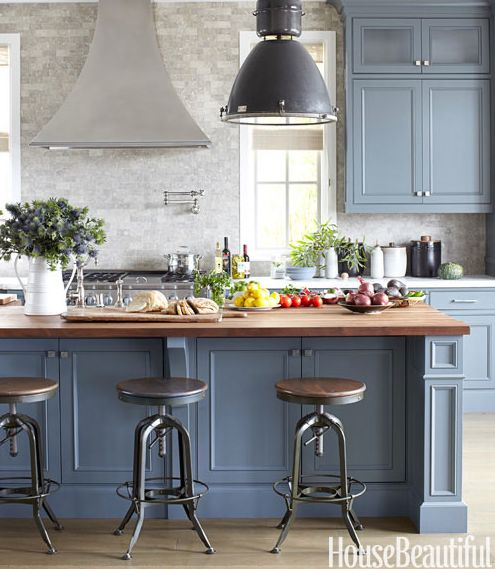 This is probably the best way I could live with blue - mixed with warm woods and industrial accents.