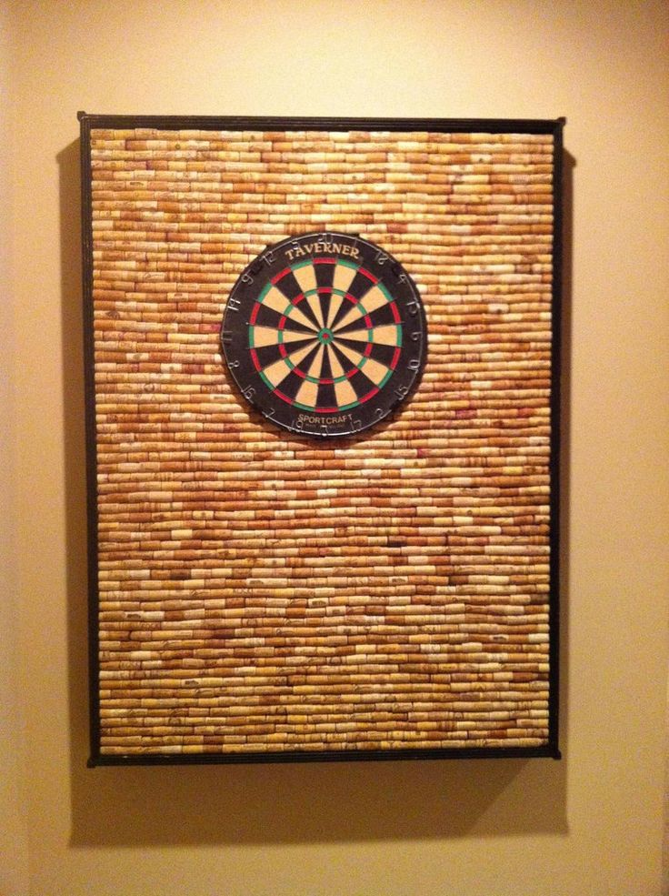 Dartboard -with corks- great idea but I should probably get to drinking a lot more wine! Love for a game room