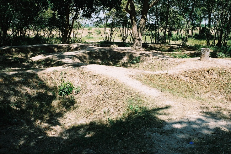 The Killing Fields , a pathway between mass grave pits. The Killing Fields are 15km from Phnom Penh.
