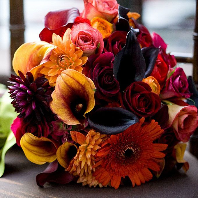 Brides.com: . Arrangement of dahlias, calla lilies, roses, ranunculuses, and Gerbera daisies. Bouquet by Steven Bruce Design