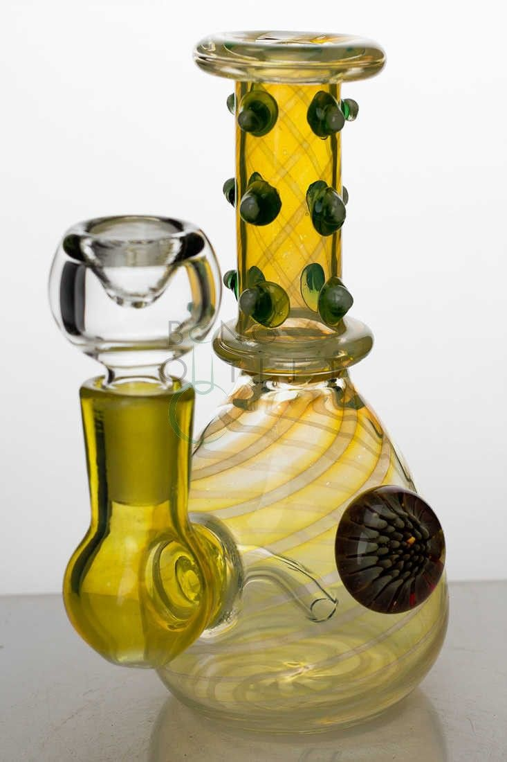 Buy 6 in. changing color glass water bong-2869 from Noname of Assorted color. It features a Fixed-stem Diffuser and Thick Bowl for 14 mm female Joint.