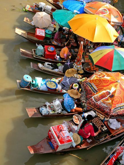 Fruits, vegetables, flowers, and food tempt buyers at floating markets across Thailand.