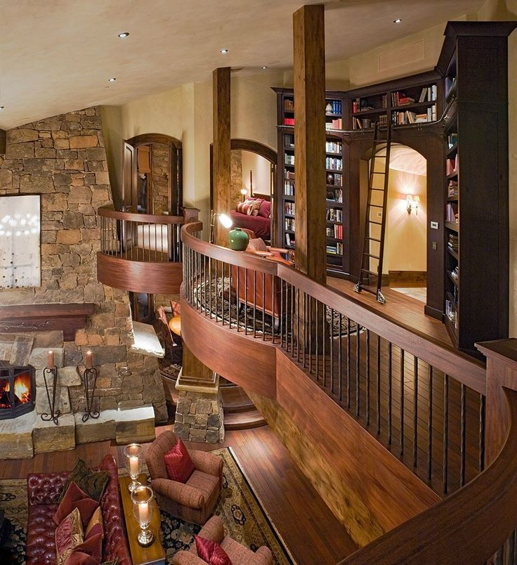 Very nice looking area... built-in book cases, wood and stone, overlooking the living room.