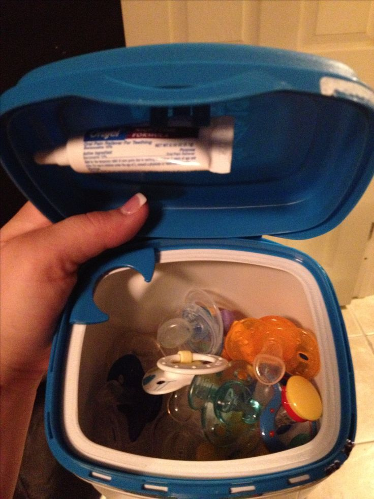Formula container into an orajel and pacifier box. brilliant!! Been wondering what I could do with all those formula containers.