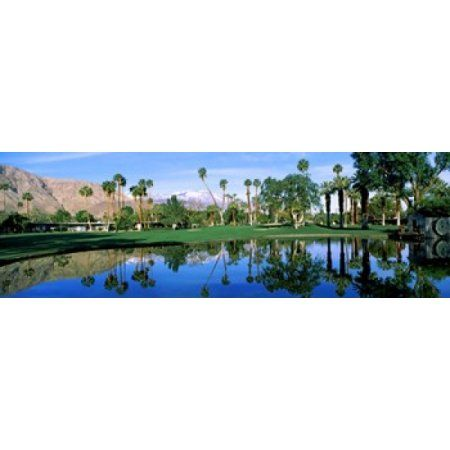 Reflection of trees on water Thunderbird Country Club Rancho Mirage Riverside County California USA Canvas Art - Panoramic Images (18 x 6)