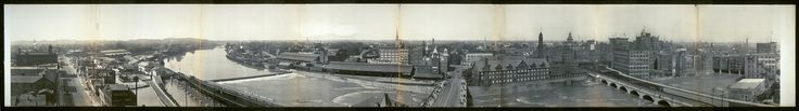 Panoramic view from Rochester Business Institute.  This 180 degree panoramic view (c. 1906) faces South on the left, West in the middle and North on the right.  From left to right: South Avenue, Erie Canal, Lehigh Valley Railroad Terminal, Genesse River, Erie Railroad Terminal, Court Street Bridge, Kimball Tobacco Factory (current location of the Blue Cross Arena), Erie Canal Aquaduct (currently the Broad St. bridge),  Main Street Bridge (which supported buildings back then).