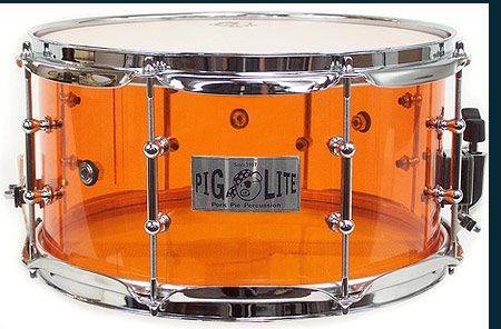 "Pork Pie's Acrylic Amber PigLite snare drum.  Mine is customized with dual 4"" diameter cannon holes in the shell."