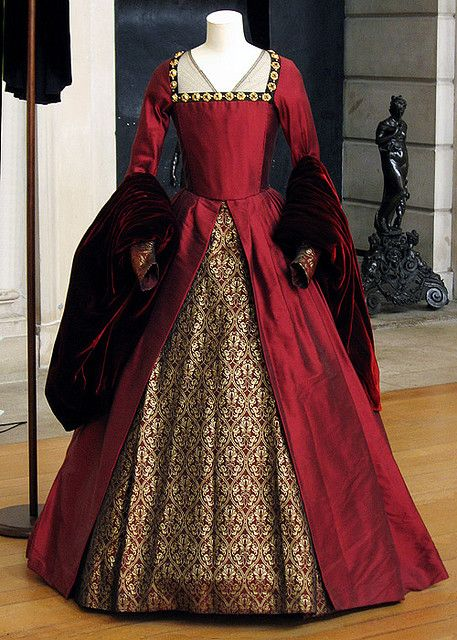 Gown from The Other Boleyn Girl. Simple, clean and well executed. Bold red, stunning. I would have to load (mess) it up with a million fussy details