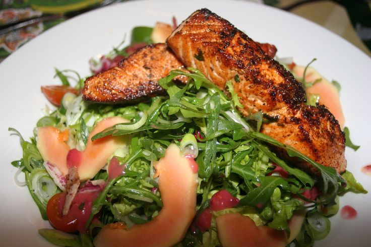 Blackened Salmon Salad: Perfectly cooked cajun seasoned fillet of salmon, served on a mixed leaf salad bed with cherry tomatoes, papaya & spring onion, topped with raspberry balsamic vinaigrette. A healthy choice! http://www.therainforestcafe.co.uk/menus/mainmenu.asp