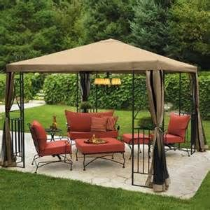 Garden gazebo set with iron framework. Cheap gazebos don't always last but this will last a lifetime